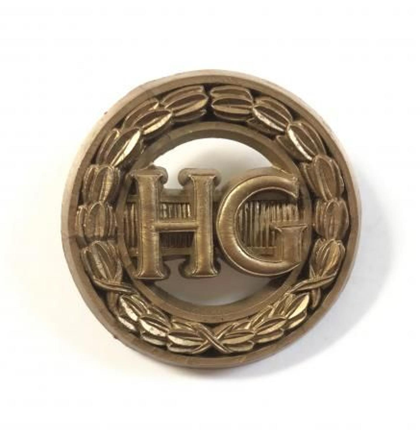WW2 Woman Home Guard Auxiliary Plastic Economy Issue HG Badge.