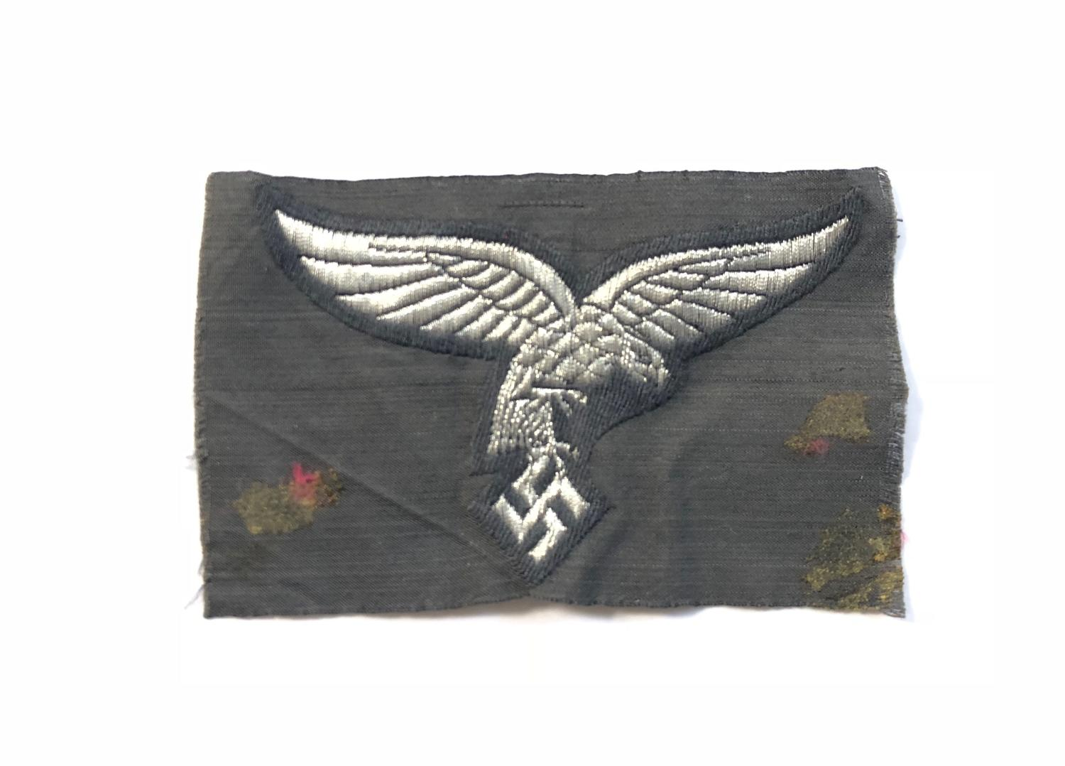 WW2 Luftwaffe BeVo cloth 'drop tail' eagle Badge.