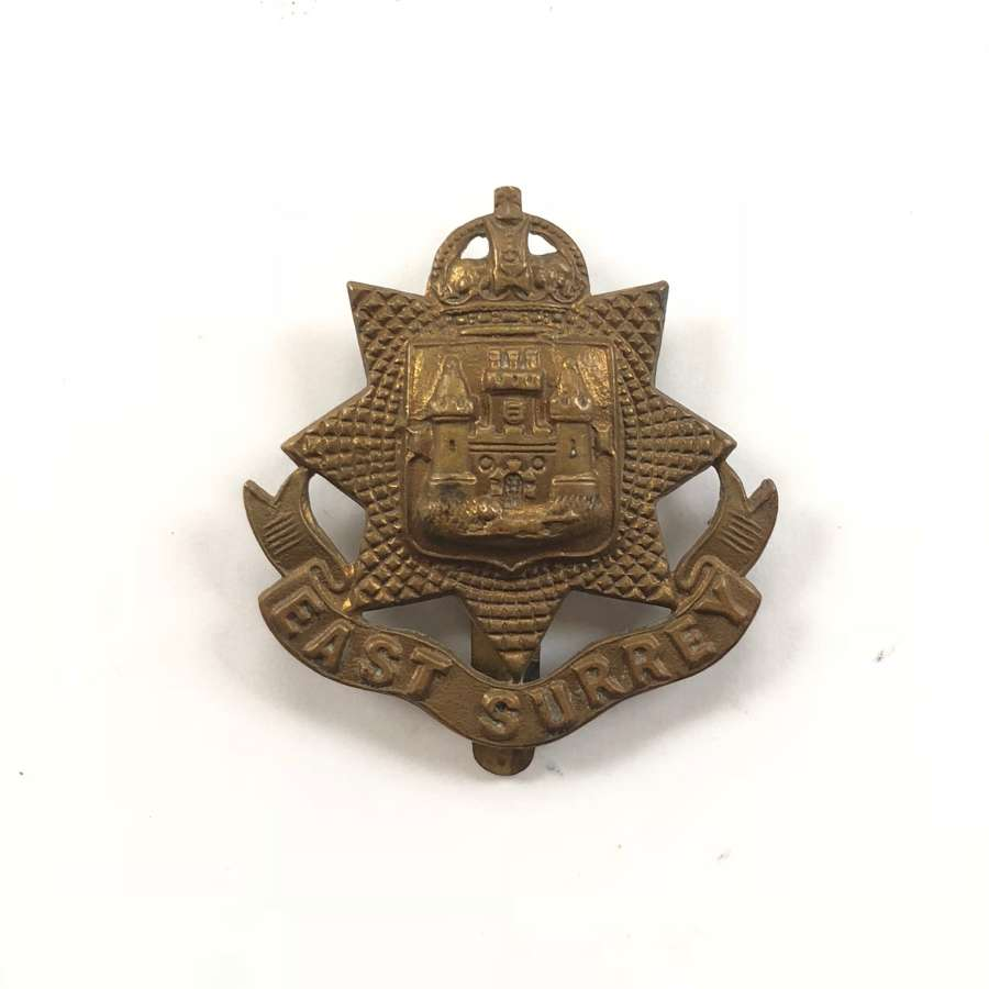 WW1 East Surrey All Brass Economy Cap Badge.