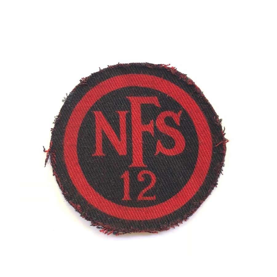 WW2 NFS 12 (Stevenage) circular red on navy printed cloth breast badge