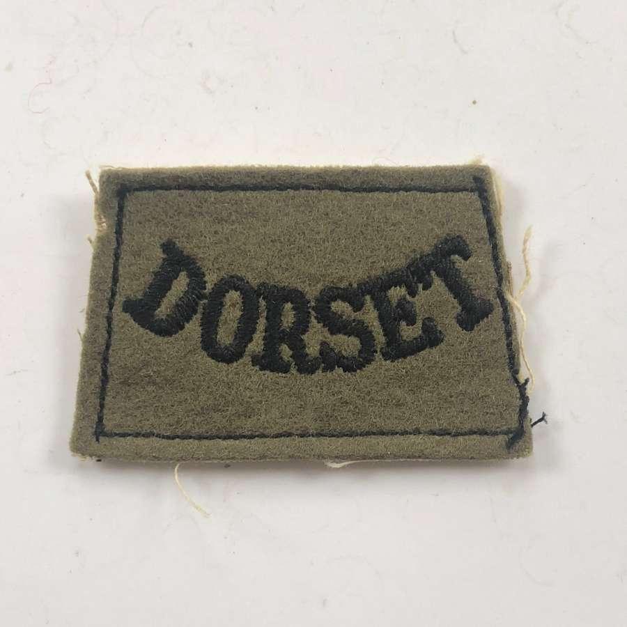 WW2 Dorset Regiment Slip on Shoulder Title.