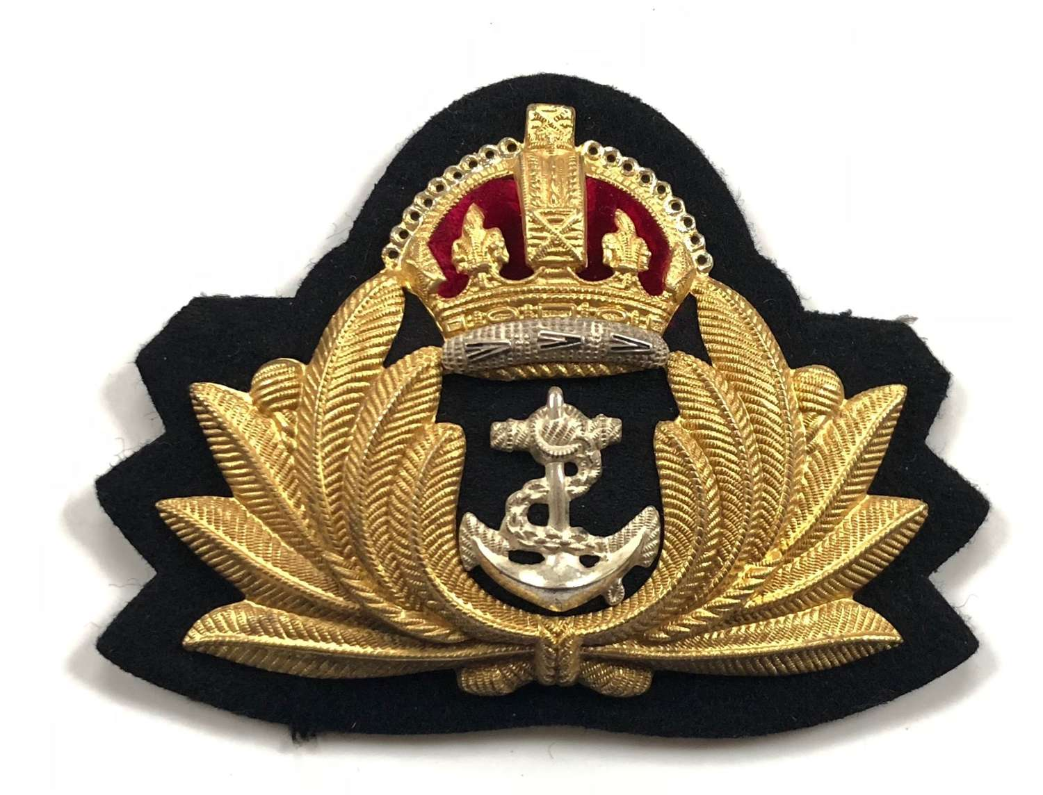 WW2 Royal Navy Officer's Economy Pattern Cap Badge by Gaunt London.