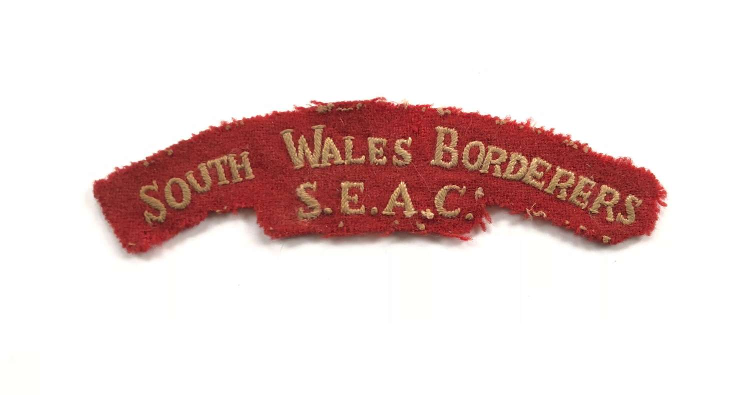 South Wales Borderers SEAC Cloth Shoulder Title Badge.