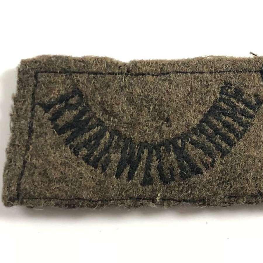 WW2 Royal Warwickshire Regiment Cloth Slip on Title Badge.